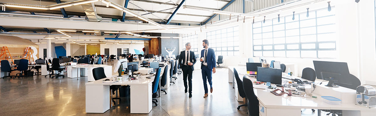 two men walking in office