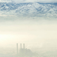 factory haze and mountains